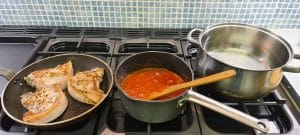 Cooking the pork chop and pasta